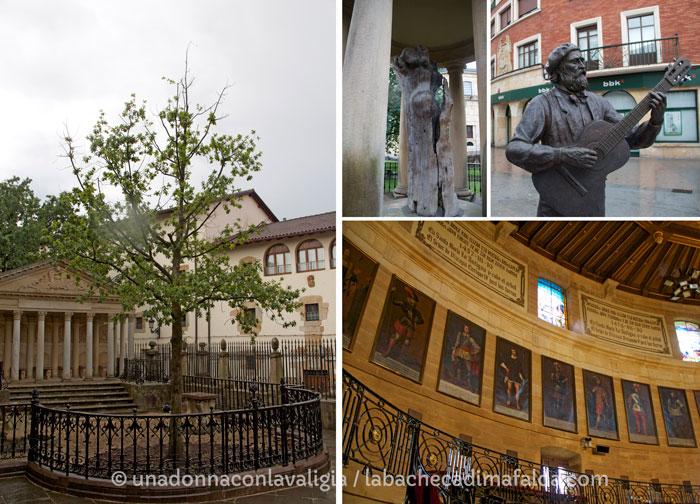 L'Albero di Guernica nel giardino della Casa de Juntas / la statua del poeta suo cantore neele strade della cittadina / i Signori di Biscaglia ritratti nella Sala circolare.